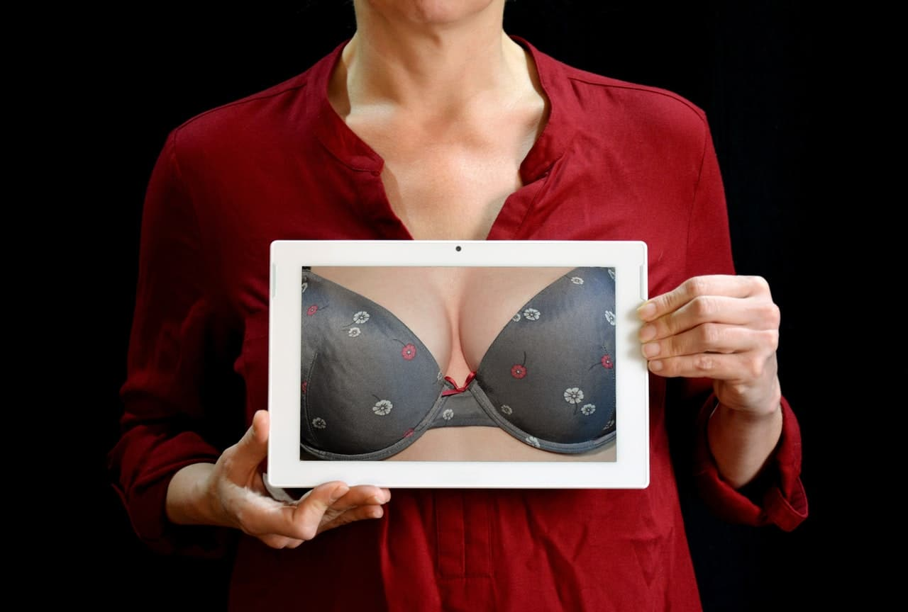 woman holding tablet to chest showing bread reduction image